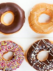 Glazed Doughnuts with colorful sprinkles, chocolate