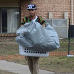 Detwan Williams loads some of his personal belongings into his car Thursday at the Arbors.