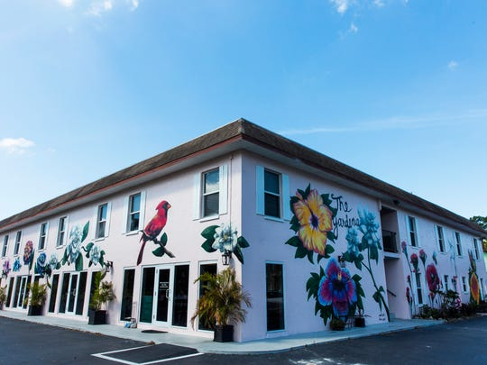A mural depicting various flowers decorates the side of Naples Beach and Bay Realty in the Bayshore Arts District of Naples, Florida on Monday, April 2, 2018.