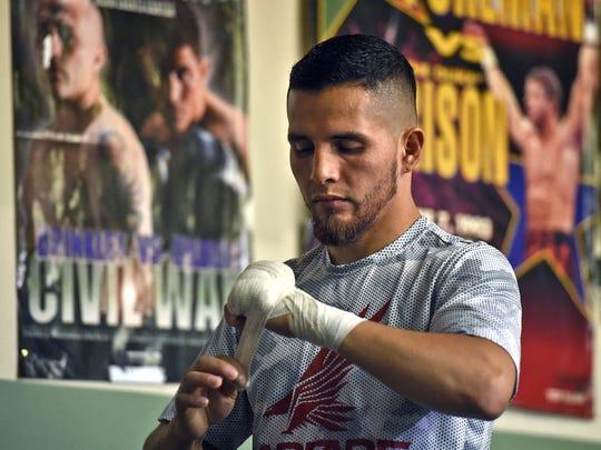 Reno boxer Oscar Vasquez wraps his hands for a sparring
