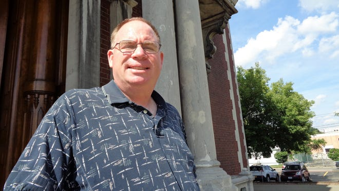 Frank Frear Jr. volunteers to take visitors through the Phelps Mansion Museum in downtown Binghamton, and calls the task an honor.
