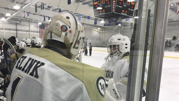 Indian Hills goaltenders Joe Bagi (facing) and Max