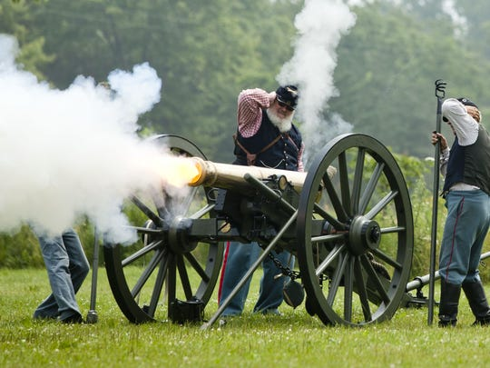 Civil War Days re-enactors fire a cannon at at the
