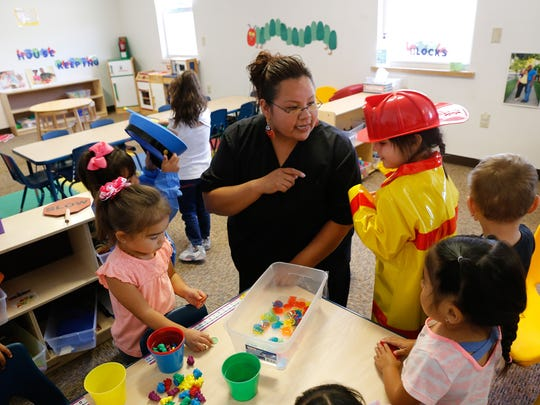 Early pre-kindergarten teacher Nishoni Johnson talks with her students Thursday at A Gold Star Academy on Crouch Mesa.