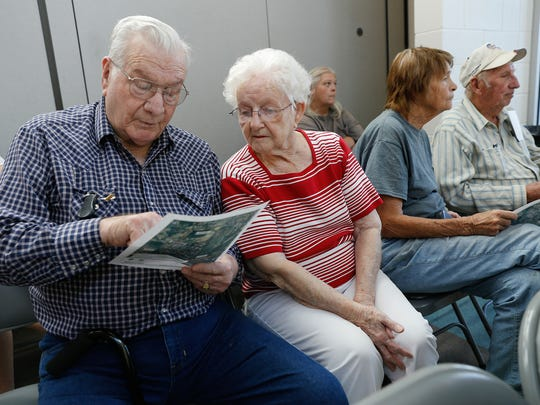 Totah subdivision residents Ernest and Nell Burton look over a map of their neighborhood during a meeting Thursday at the Sycamore Park Community Center in Farmington.