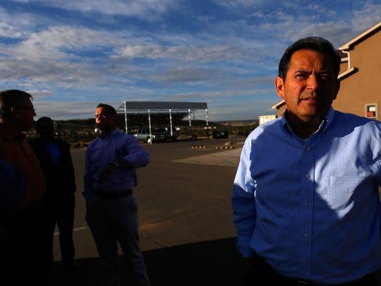 Lt. Gov. John Sanchez visits the offices of  AV Water Co. on Monday in Farmington.