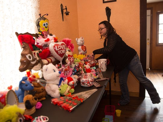 Nichole Weaver, owner of N&J's Sweets and Treats, talks about a her products Thursday at her home business in Bloomfield.