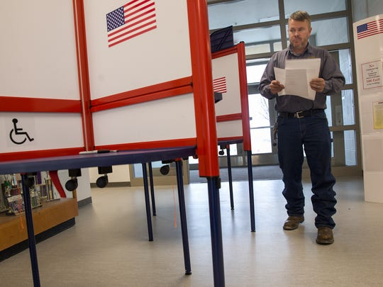 Walter Eaton votes, Tuesday, Feb. 7, 2017 at Judy Nelson Elementary School in Kirtland in this file photo. Farmington residents have their chance Tuesday to vote on a bond to a levy for school technology funding.