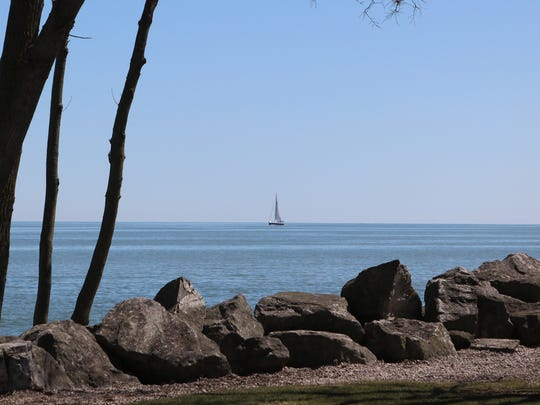 Democratic gubernatorial candidate Dennis Kucinich took a moment to mention how peaceful the sight of a sailboat floating by appeared to him during a campaign stop at the Marblehead Lighthouse on Thursday.