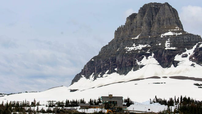 """Crews have met after breaking through """"the big drift"""" on the Going-to-the-Sun Road, photographed here during 2018's plowing efforts."""