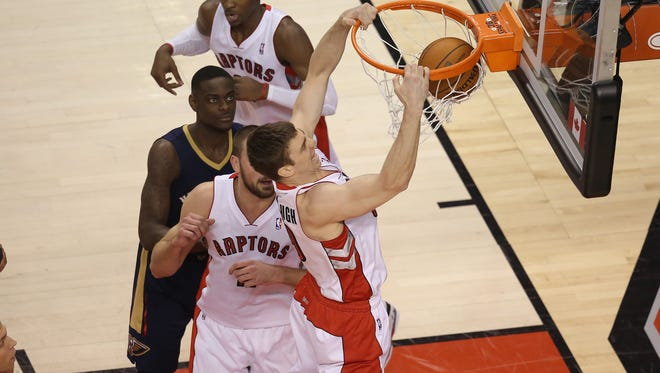 Toronto Raptors forward Tyler Hansbrough (50) dunks against the New Orleans Pelicans at Air Canada Centre. The Raptors beat the Pelicans 108-101.