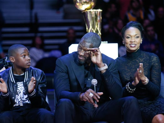 Pistons great Ben Wallace wipes away tears sitting