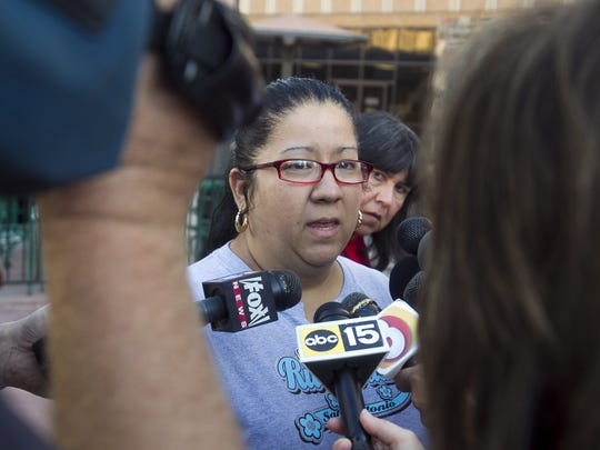"""Victim family member Michelle Nunez speaks to the media Oct. 31, 2011, outside the courthouse after a jury convicted Mark Goudeau of nine counts of first-degree murder and dozens of other charges attributed to the """"Baseline Killer"""" in Phoenix."""