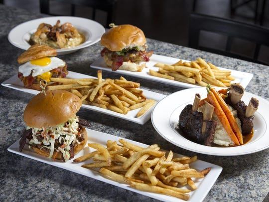 The menu items at Chop Shop in Seaside Heights include (clockwise from back left) shrimp and grits, the Alice Cooper burger, braised short ribs, the Fat Dom sandwich and the Brunch Burger.