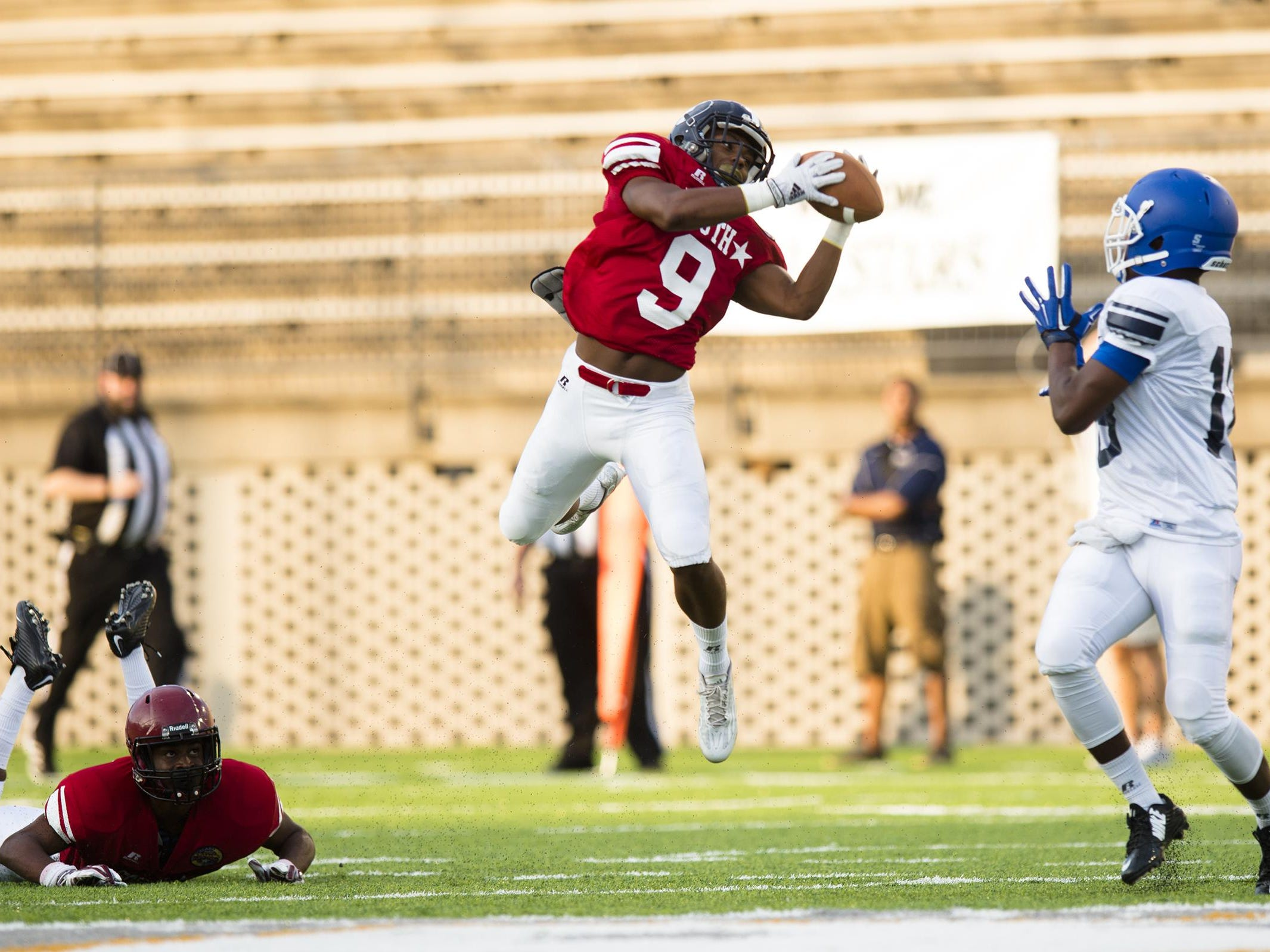 South All-Star Wendell Harris of Foley intercepts a pass intended for North All-Star Eddie Williams of Tuscaloosa County during the AHSAA North vs. South All Star game on Friday, July 17, 2015, in Montgomery, Ala.
