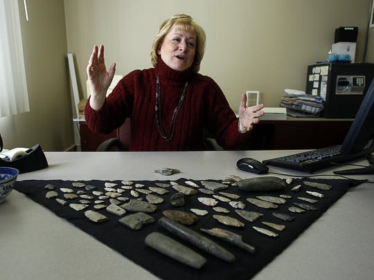 Deb Malewski, vice president of the Eaton Rapids Area Historical Society, talks about some of the 120 American Indian artifacts donated by the family of the late Beverly Ellsworth at her office in Eaton Rapids.