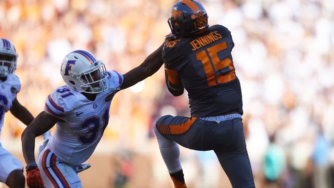 Tennessee wide receiver Jauan Jennings (15) jumps to catch a pass above Florida defensive back Anthony Gilga (31) during the first half at Neyland Stadium on Saturday, Sept. 24, 2016.