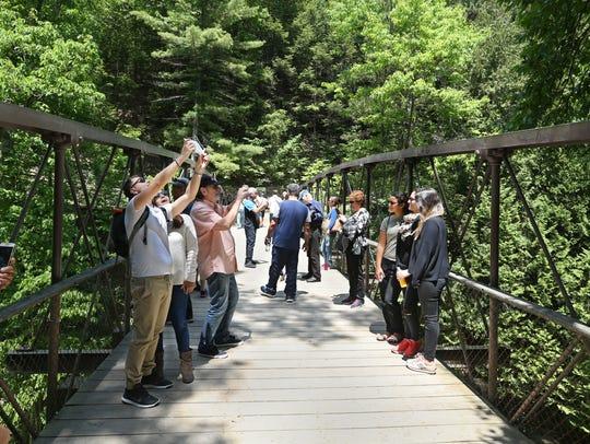 "Visitors crowd onto the Suspension Bridge to take ""selfies"""