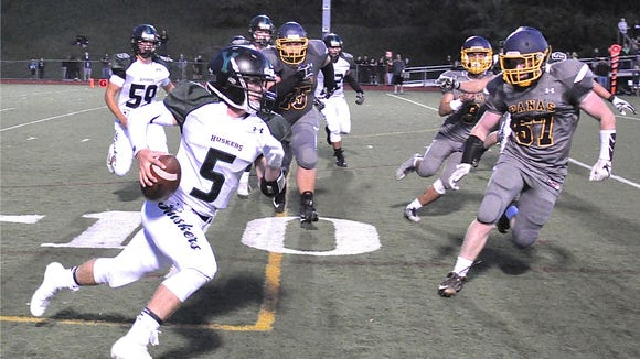 Yorktown quarterback Tommy Weaver tries to get outside