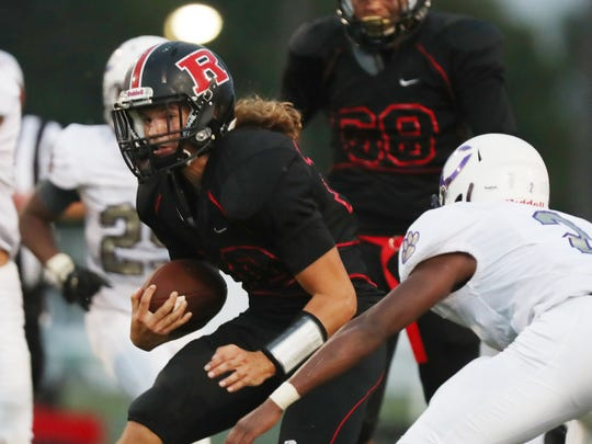 Rossview's Kayden Miller (10) runs for a first down during the first game of the season against Clarksville at Rossview High School Friday, Aug. 17, 2018, in Clarksville, Tenn.
