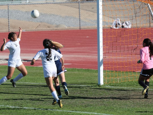 Above: Shadow Hills' Natalie Navarro's header goal attempt against Alverno goes wide in the first half on Tuesday in Indio. Shadow Hills won the CIF second-round game 2-0.
