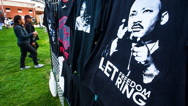 A tee-shirt with a likeness of MLK hangs at a booth at the Martin Luther King, Jr. Day Festival at Margaret T. Hance Park in downtown Phoenix, Monday, January 16, 2017,  honoring the civil rights leader.