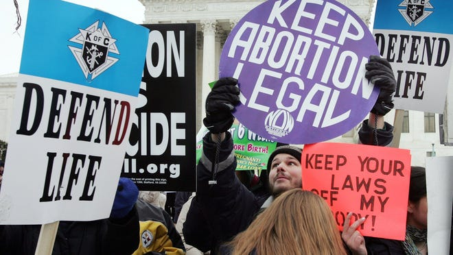 Advocates on both sides of the abortion debate protest outside the U.S. Supreme Court in 2005.