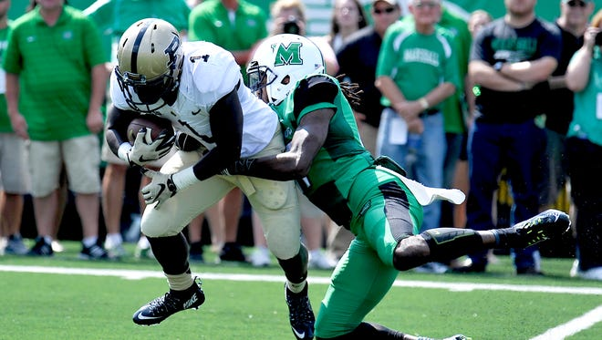 Purdue's D.J. Knox (1) runs the ball with a Marshall defender trying to take him down during an NCAA college football game in Huntington, W.Va., Sunday, Sept. 6, 2015. (AP Photo/Chris Tilley)