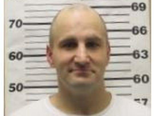 Tim Evans shown in a previous mugshot.