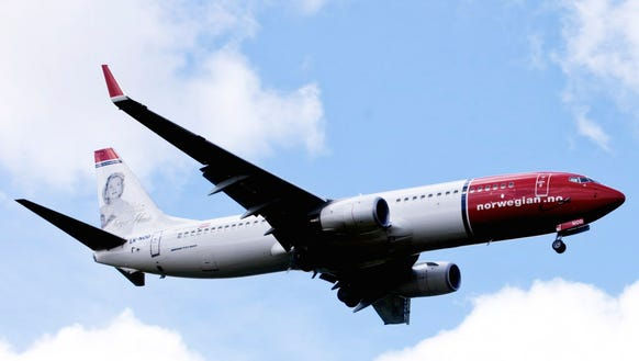 A Boeing 737-800 of low-cost airline Norwegian flies