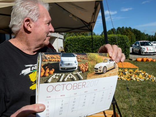 George Cummings of Greenville holds a Fiat car calendar, with a photograph of his car at the Disciples United Methodist Church pumpkin patch from 2016 in Greenville. Many United Methodist Churches have pumpkin patches across the country, which benefits at least 700 Native American workers in New Mexico, and various missions from each church.