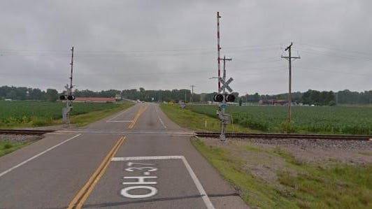 Ohio Route 37 looking east toward the railroad crossing where the truck-train crash occurred late Monday afternoon, Aug. 10, 2020.