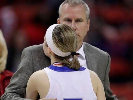 Amherst girls basketball coach Gregg Jensen and daughter Geena Jensen (5) are one of several families across the state who are tasked with the challenge of navigating the relationship between parent/coach and child/athlete on the same team.