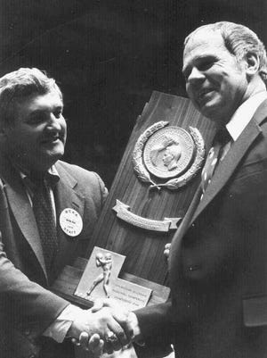 FILE--Michigan State coach Jud Heathcote, right, receives the NCAA Championship trophy, in this 1979 MSU file photo, from Wayne Duke, left.  Heathcote's coaching career ended when the Spartans lost to Weber State 79-72 in the NCAA Southeast Regional tournament, Friday, March 17, 1995, in Tallahassee, Fla. Heathcote's 24-year coaching career, 19 at Michigan State, ended with a record of 340-220 at Michigan State and 420-273 overall, and one NCAA title in 1979. (AP Photo/Michigan State, file)