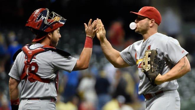 St. Louis Cardinals left fielder Matt Holliday (right) celebrates with catcher Tony Cruz (left) after the Cardinals beat the Milwaukee Brewers 7-6  at Miller Park.