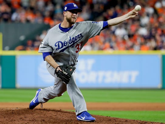 Los Angeles Dodgers relief pitcher Tony Watson throws