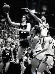 MARCH 10, 1972: Elder's Steve Grote (35) scores on