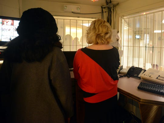 Madison Commissioner Katie Brantley and Judge Christy Little stand inside the control room of the Madison County Juvenile Court Services Center in February 2014.