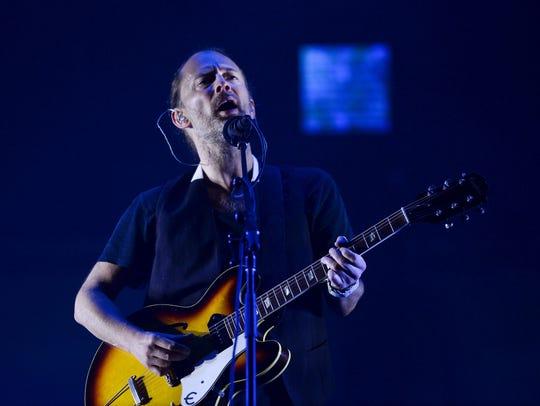Radiohead lead singer Thom Yorke performing on July