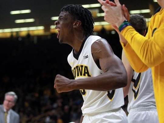 Iowa's Tyler Cook celebrates a basket during the Hawkeyes'