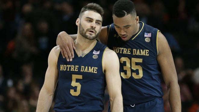 Mar 7, 2018; New York, NY, USA; Notre Dame Fighting Irish guard Matt Farrell (5) and forward Bonzie Colson (35) react against the Virginia Tech Hokies during the second half of a second round game of the 2018 ACC tournament at Barclays Center at Barclays Center. Mandatory Credit: Nicole Sweet-USA TODAY Sports