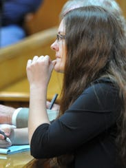 Sara Anne Woody, 25, watches as closed circuit television
