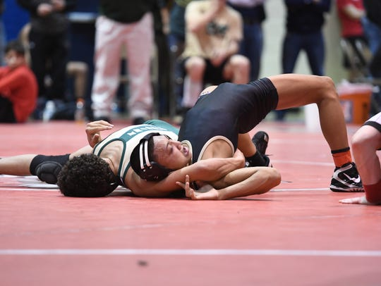 BCCA Holiday Tournament on Thursday, December 28, 2017, at Hackensack High School. (left) Sammy Alvarez, of St. Joseph, battles Sean Faraon, of Paramus Catholic, in their 120 pound match.