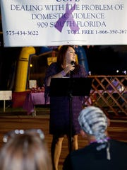 COPE Director Veronica Gutierrez speaks at last year's vigil for domestic violence victims and survivors.