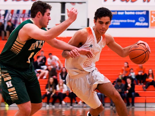 Northville's Gustaf Tjernberg (right) drives to the