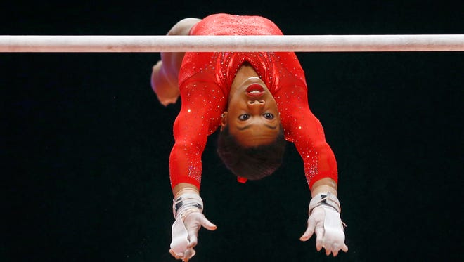 Gabby Douglas of the U.S. performs on the uneven bars during the women's all-around final competition at the World Artistic Gymnastics championships at the SSE Hydro Arena in Glasgow, Scotland.