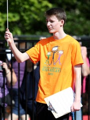 Bryant Williams, 15, volunteers at the Country Kids Relays on Saturday, May 9, 2015, in Salem, Ore. Williams raced in the event for six years when he was younger.