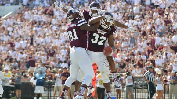 Mississippi State wide receiver Justin Johnson (81) and wide receiver Donald Gray (6) and running back Ashton Shumpert (32) celebrate after a touchdown by Shumpert  during the first quarter of the game against the Northwestern State Demons at Davis Wade Stadium. Mandatory Credit: Matt Bush-USA TODAY Sports