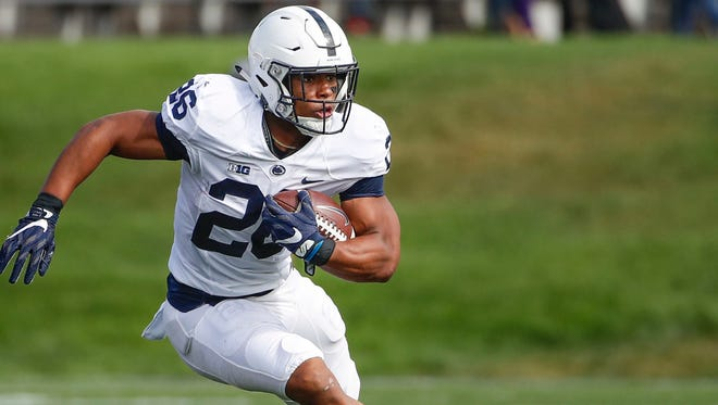 Penn State Nittany Lions running back Saquon Barkley rushes against the Northwestern Wildcats during the first half at Ryan Field.