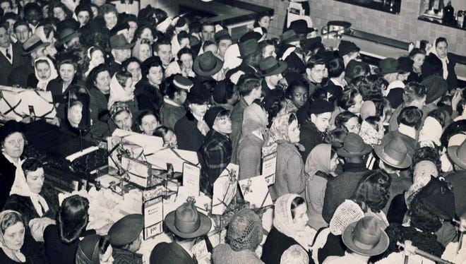 "A Christmas shopping ""riot"" is shown Dec. 15, 1945 at Grant's department store in downtown Louisville."